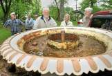 """From a DLN article: Gene Gagliardi, in tan jacket, and his wife, Joan, look at a cast iron fountain they once owned as [Friends of Marshall Square Park] volunteers prepare to unload and return it to Marshall Square Park in West Chester on Monday, May 14, 2012. A committee is in the works to have it restored and placed back in the park after it was removed decades ago. Photo: Vinny Tennis, DLN Staff A video of the """"capture and return"""" adventure is on our website at Home, Projects, Original 1889 Fountain, The Year 2012."""