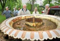 "From a DLN article: Gene Gagliardi, in tan jacket, and his wife, Joan, look at a cast iron fountain they once owned as [Friends of Marshall Square Park] volunteers prepare to unload and return it to Marshall Square Park in West Chester on Monday, May 14, 2012. A committee is in the works to have it restored and placed back in the park after it was removed decades ago. Photo: Vinny Tennis, DLN Staff A video of the ""capture and return"" adventure is on our website at Home, Projects, Original 1889 Fountain, The Year 2012."