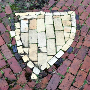 A shield of yellow bricks in honor of the Union Veteran Legion. Yes, needs attention. Photo: JAS September 16, 2005