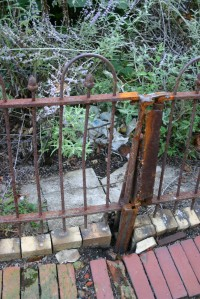 1889 ORIGINAL IRON FENCE IN 2005. Click to enlarge detail.
