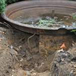 Fountain Dig: Aha!—what a mess. Out of five tiers, the basin shown above is the first and largest. The next three recovered tiers are safely stored, waiting restoration. The fifth tier is missing and slated for replication.