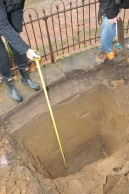 Fountain Dig: The bottom. Anne's tape measure says the investigative excavation is about 4 feet deep.